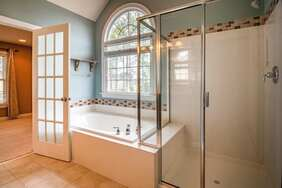 Clean interior bathroom. Glass shower and window have no blemishes or scuffs.