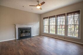Empty living room with four beautiful windows. Clean windows let in the light.
